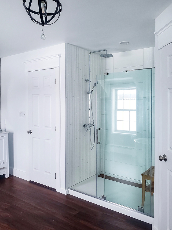 Factor 8 white laminate shower wall panels for a grout free shower | Innovate Building Solutions | #glassblock #Showerdoor #laminatewallpanels #Wallpanels