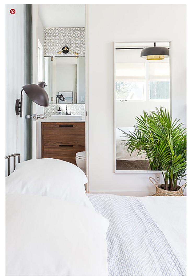 Small bathroom idea 3 out swing your bathroom door credit shiftmodernhome.com | Innovate Building Solutions | #Bathroom #WalkInShower #Remodel #ShowerRemodel