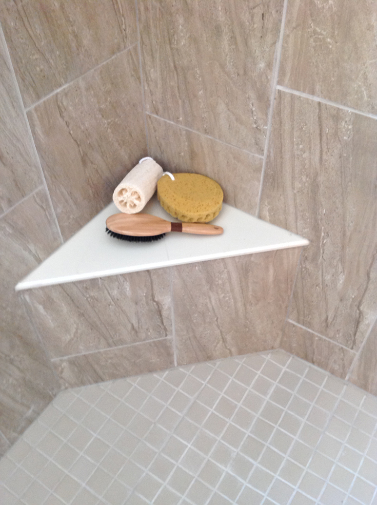FAQ 6 solution 1 corner seat in a tile shower | Innovate Building Solutions | #CornerSeat #BenchSeat #ShowerSeat