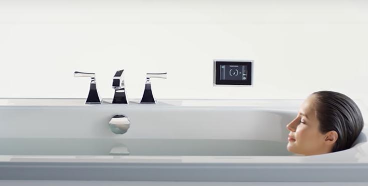 Feature 1 women - woman in tub relaxing | Innovate Building Solutions | #SoakerTub #BathroomRemodel #ShowerTub