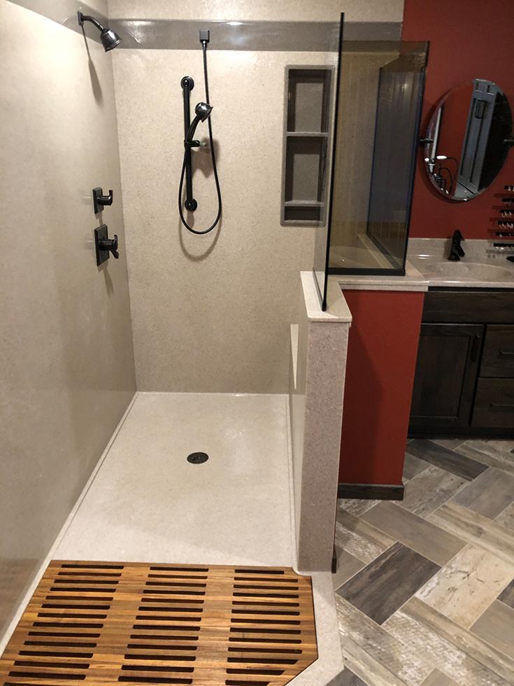 Factor 4 custom size cultured granite shower pan in a bathroom remodel | Innovate Building Solutions | #ShowerBase #BathroomRemodel #RollInShower #Lowprofile