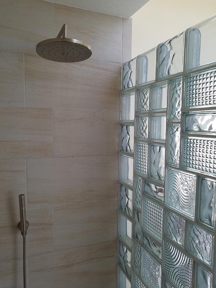 Idea 8 glass block mosaic shower design for an alcove shower | Innovate Building Solutions | #Glassblock #ShowerDesign #bathroomRemodel