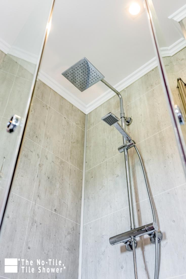 Idea 9 rain head in a grout free laminate shower wall panel system | Innovate Building Solutions | #ShowerHead #RainHead #BathroomRemodel