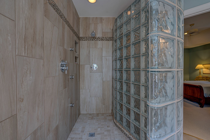 Shape 1 gently curved custom glass block walk in shower | Innovate Building Solutions | #CurvedWall #GentleyCurved #Glassblockwall