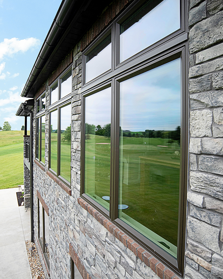Pro 4 brown casement windows in a stone veneer home cleveland ohio | Innovate Building Solutions #VinylWindows #CasementWindows #BrownWindows