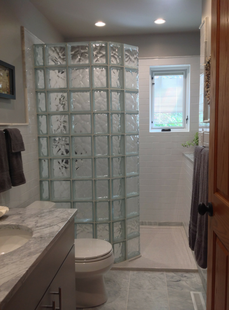 Tip 2 curved glass block shower and a solid surface custom shower pan | Innovate Building Solutions #Customshower #SHowerPan #Glassblock #GlassShower