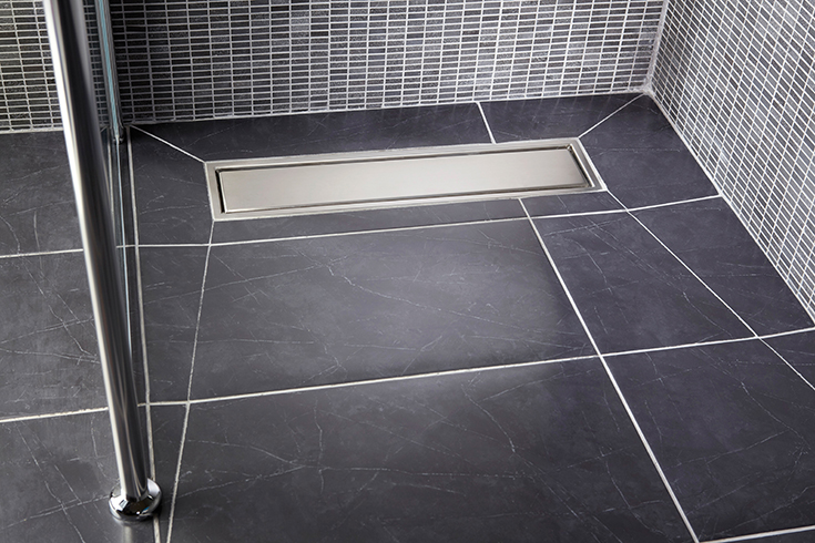 Tip 3 close to the edge linear shower drain location in a tile shower   Innovate Building Solutions #TileShower #linearDrain #ShowerTub