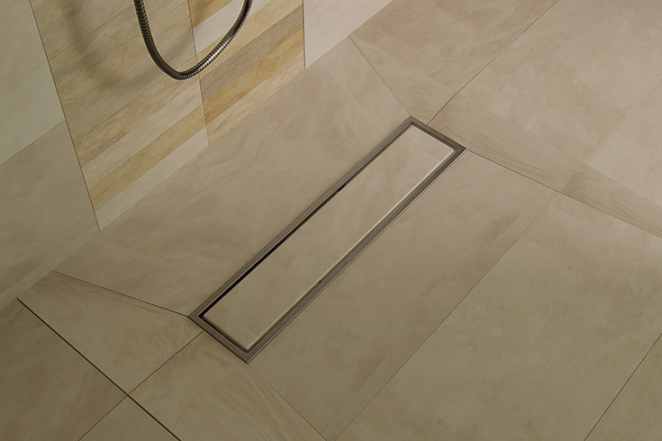 Tip 4 Look 1 large format tile in a custom ready for tile shower pan | Innovate Building Solutions #TIleFormat #ShowerPan #ShowerBase #CustomShower #LargeTle