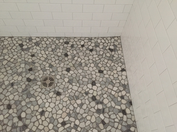 Tip 4 Look 2 pebble tile shower floor with a custom pan | Innovate Building Solutions #TileShower #Showerfloor #ShowerBase