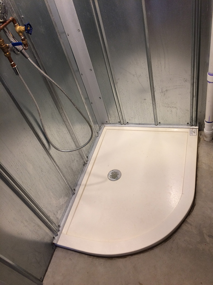 Tip 4 arc shaped custom cultured granite shower pan with a custom drain location   Innovate Building Solutions #Customdrain #Showerdrain #Showerpan