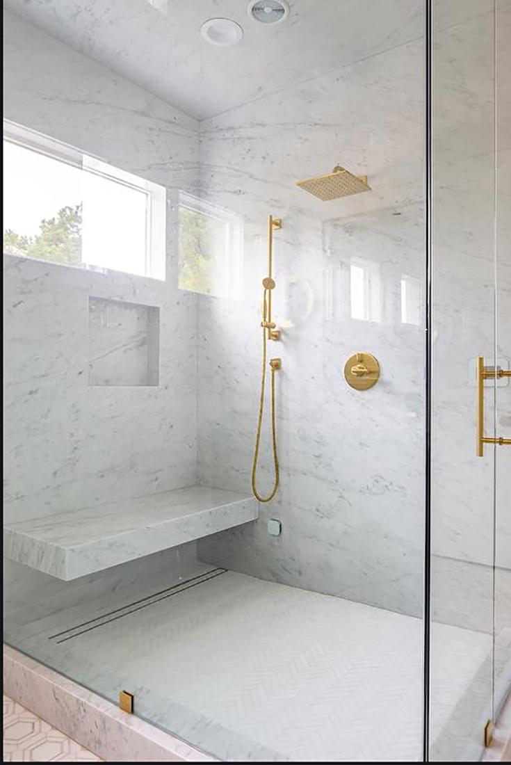 Tip 5 shower drain under a floating marble bench seat www.Decorpad Erica Bryen Design   Innovate building solutions #showerdrain #ShowerBase #MarbleBase #HiddenDrain