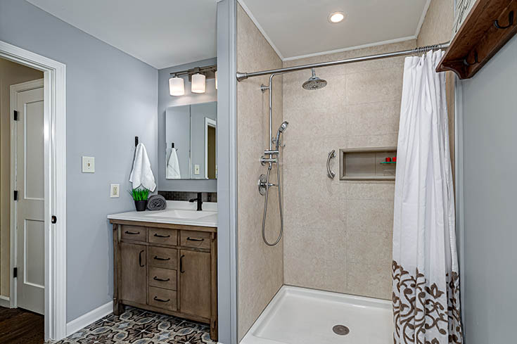 Quality 1 standard size 60 x 36 laminate shower system in sahara 24 x 12 pattern | Innovate Building Solutions #ShowerSurround #LaminateWallPanels #ShowerSystem
